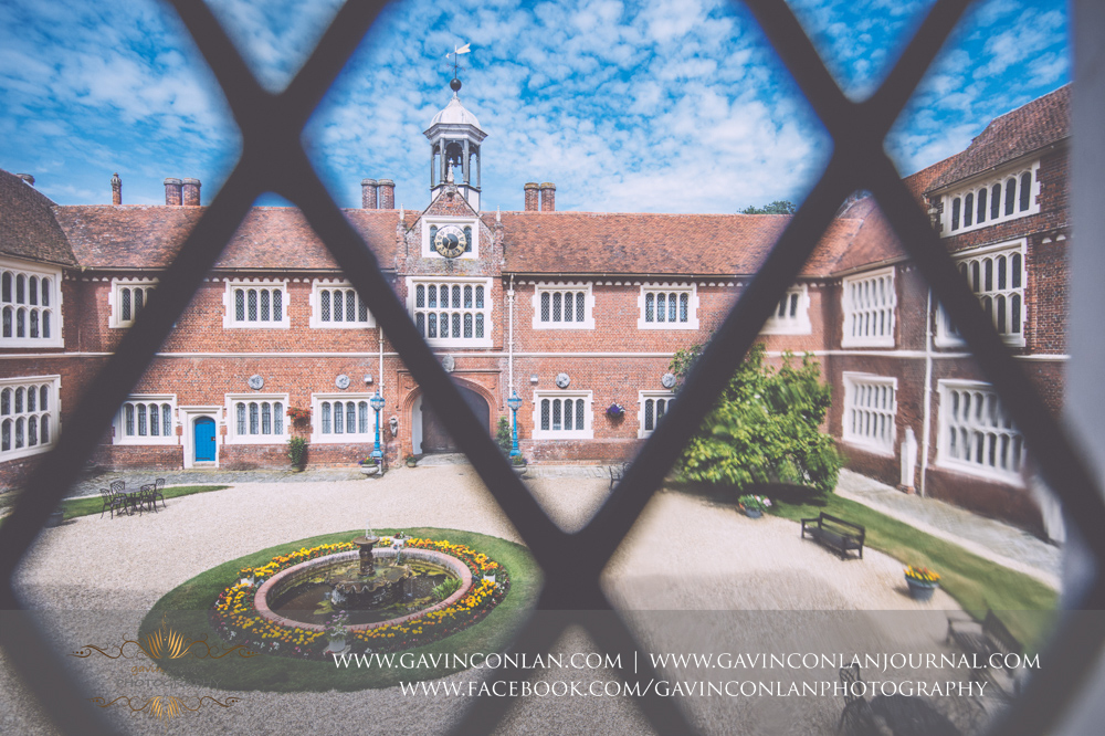 creative landscape showcasing the inner courtyard of Gosfield Hall. Wedding photography at  Gosfield Hall  by Essex wedding photographer  gavin conlan photography Ltd