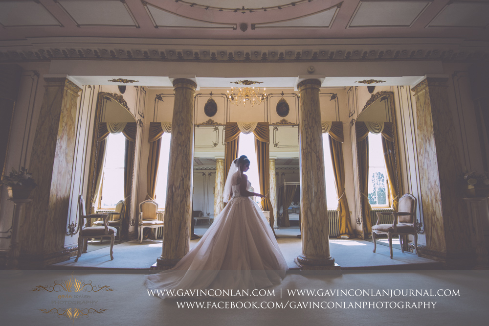 creative fine art bridal portrait in The Rococco Suite. Wedding photography at  Gosfield Hall  by Essex wedding photographer  gavin conlan photography Ltd