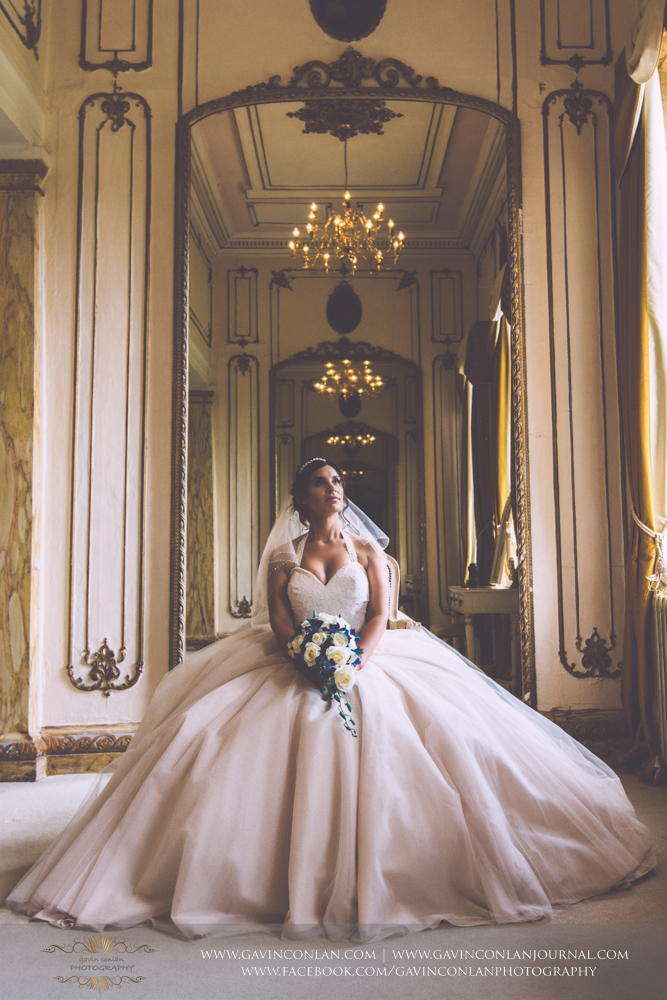 creative and elegant bridal portrait in The Rococco Suite.Wedding photography at  Gosfield Hall  by Essex wedding photographer  gavin conlan photography Ltd