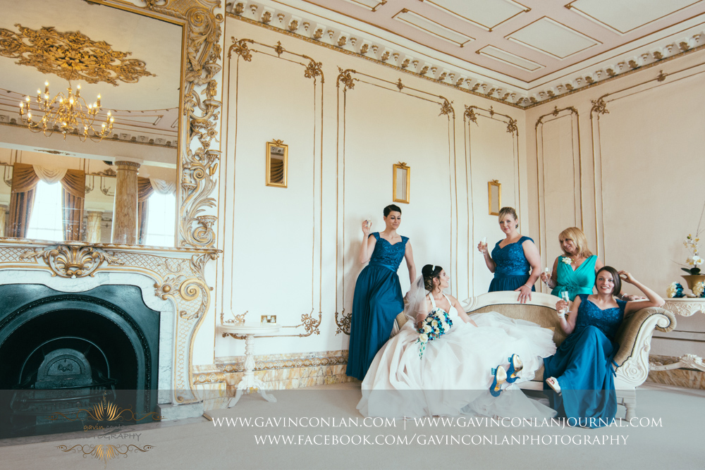 fashion portrait of the bride, her bridesmaids and her mother posing in The Rococco Suite. Wedding photography at  Gosfield Hall  by Essex wedding photographer  gavin conlan photography Ltd