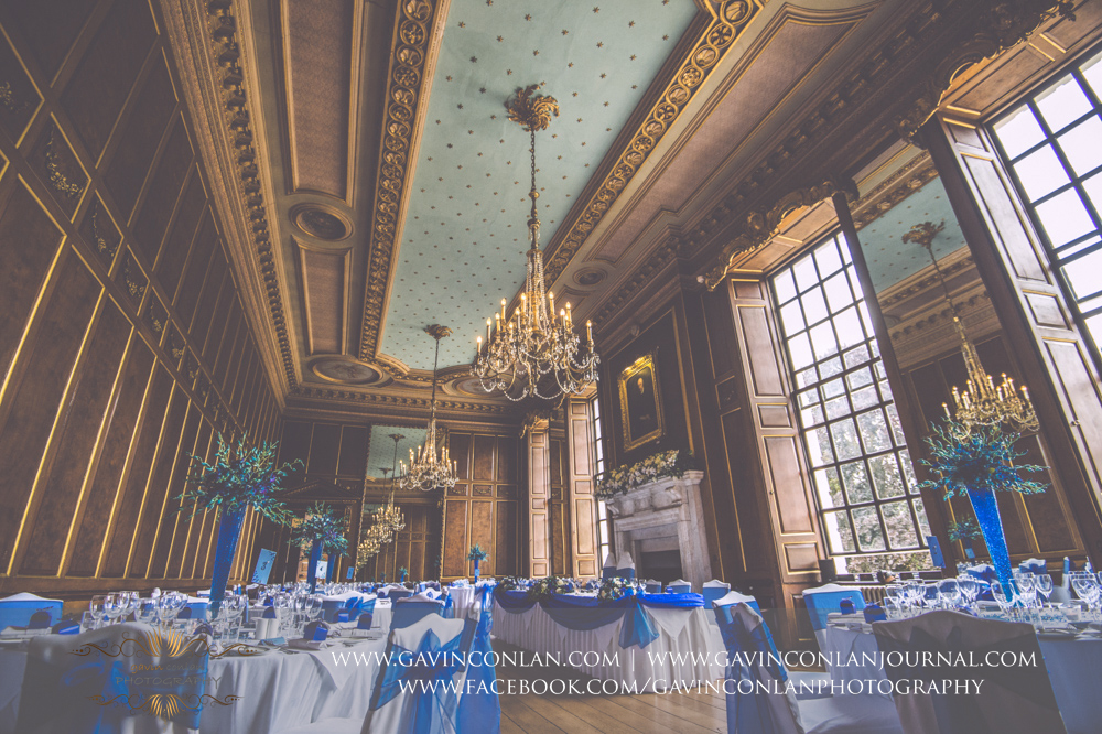 beautiful interior photograph of the ballroom all set up for Lisa and Rob's wedding breakfast. Wedding photography at  Gosfield Hall  by Essex wedding photographer  gavin conlan photography Ltd