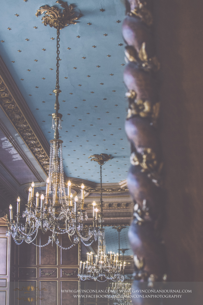 beautiful creative interior photograph of the ballroom showcasing the stunning chandeliers. Wedding photography at  Gosfield Hall  by Essex wedding photographer  gavin conlan photography Ltd