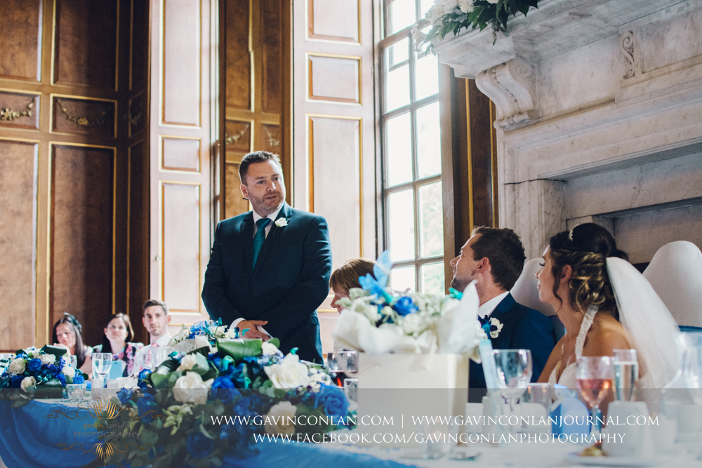portrait of the best man during his wedding breakfast speech in the ballroom. Wedding photography at  Gosfield Hall  by Essex wedding photographer  gavin conlan photography Ltd