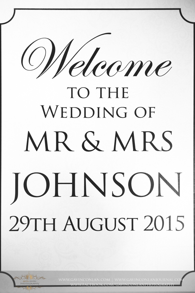 "photograph of the wedding sign saying ""Welcome to the wedding of Mr & Mrs Johnson 29th August 2015 at Great Hallingbury Manor. Essex Wedding Photography at  Great Hallingbury Manor  by  gavin conlan photography Ltd"