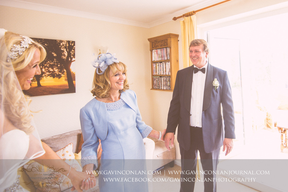 a beautiful moment as the brides father see's his daughter for the first time in her wedding dress. Essex Wedding Photography by  gavin conlan photography Ltd