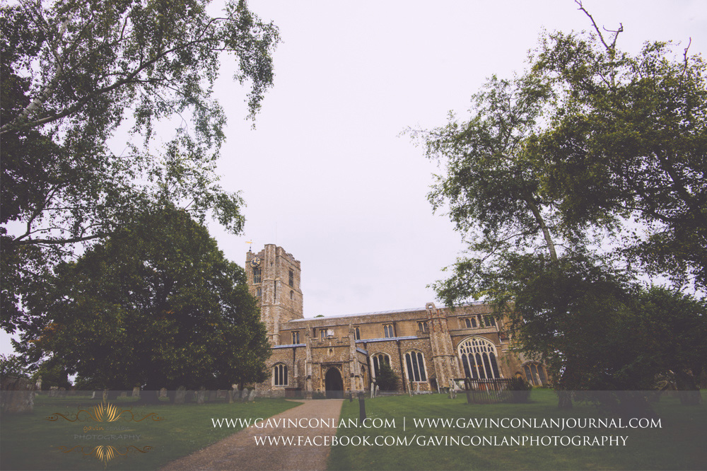 creative landscape photograph of the exterior of St Mary the Virgin Church.  Essex wedding photography at  St Mary the Virgin Church  by  gavin conlan photography Ltd