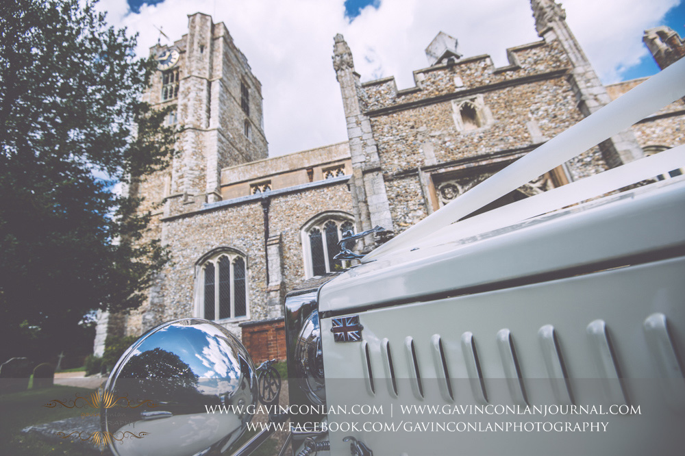 creative detail portrait of the bridal car outside St Mary the Virgin Church.  Essex wedding photography at  St Mary the Virgin Church  by  gavin conlan photography Ltd
