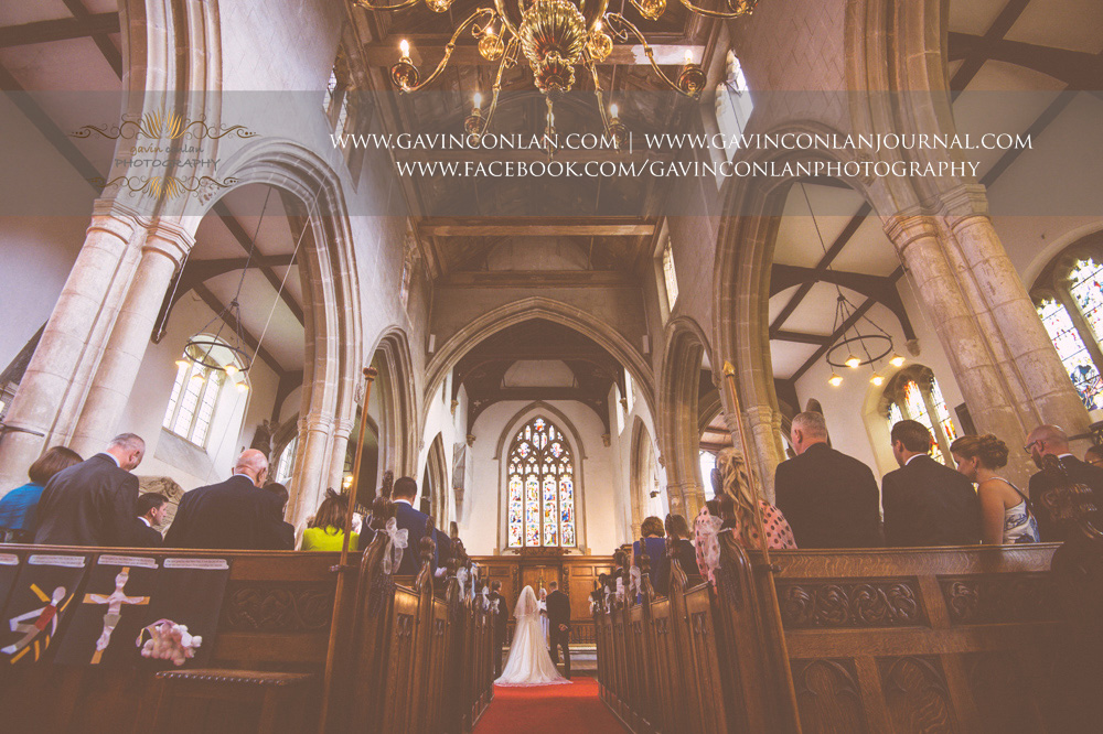 creative ceremony portrait at St Mary the Virgin Church.  Essex wedding photography at  St Mary the Virgin Church  by  gavin conlan photography Ltd