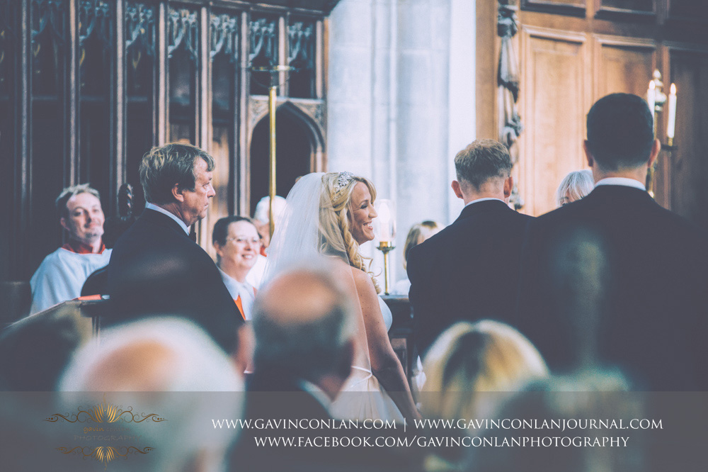 beautiful expression as the bride looks towards her groom during the ceremony at St Mary the Virgin Church.  Essex wedding photography at  St Mary the Virgin Church  by  gavin conlan photography Ltd