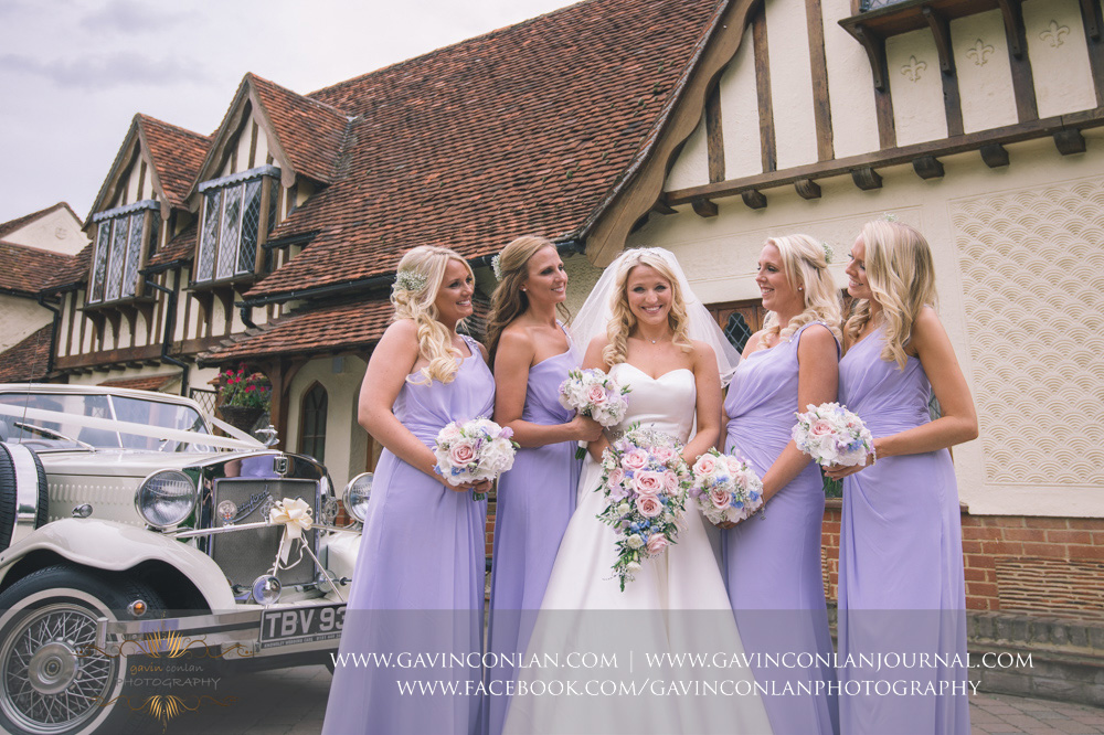 beautiful portrait of the bride and her bridesmaids outside Great Hallingbury Manor. Essex wedding photography at  Great Hallingbury Manor  by  gavin conlan photography Ltd