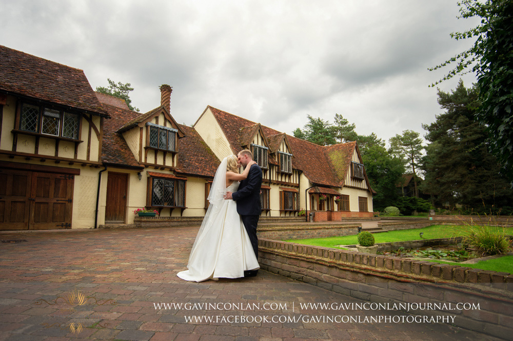 beautiful couple portrait of the couple kissing outside of Great Hallingbury Manor. Essex wedding photography at  Great Hallingbury Manor  by  gavin conlan photography Ltd