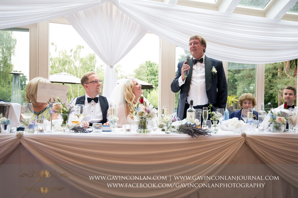 a portrait of the father of the bride during his speech at Great Hallingbury Manor. Essex wedding photography at  Great Hallingbury Manor  by  gavin conlan photography Ltd