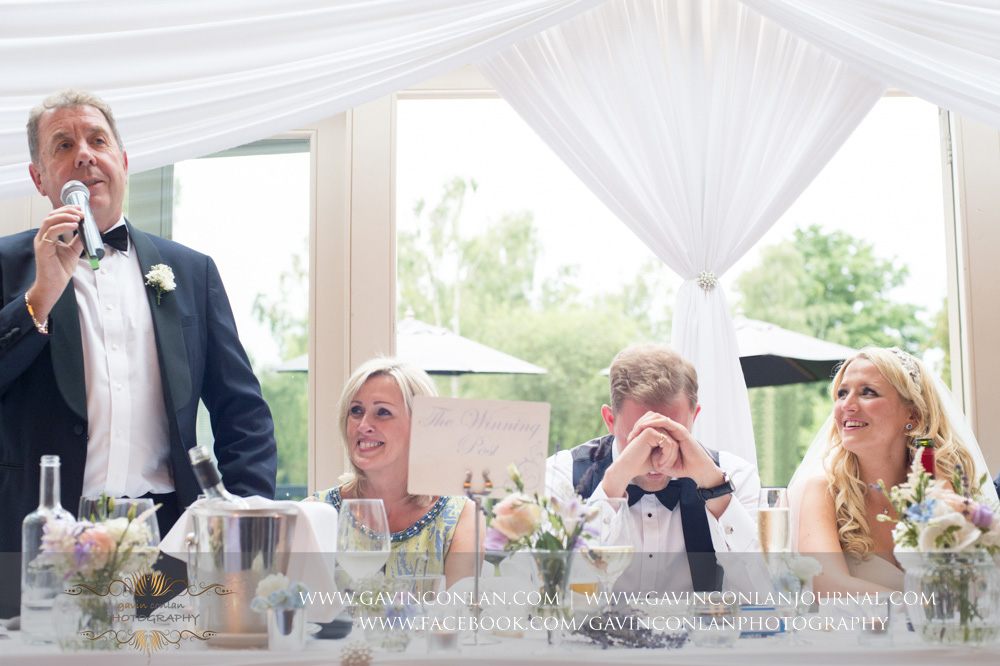 a portrait of the father of the groom during his speech at Great Hallingbury Manor. Essex wedding photography at  Great Hallingbury Manor  by  gavin conlan photography Ltd