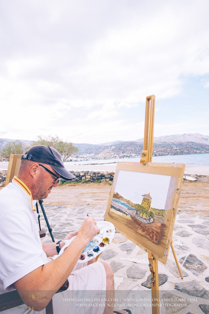 The wedding party taking an art lesson by  Visual Arts Crete  and showcasing their artisic talent in Crete, Greece by  gavin conlan photography Ltd