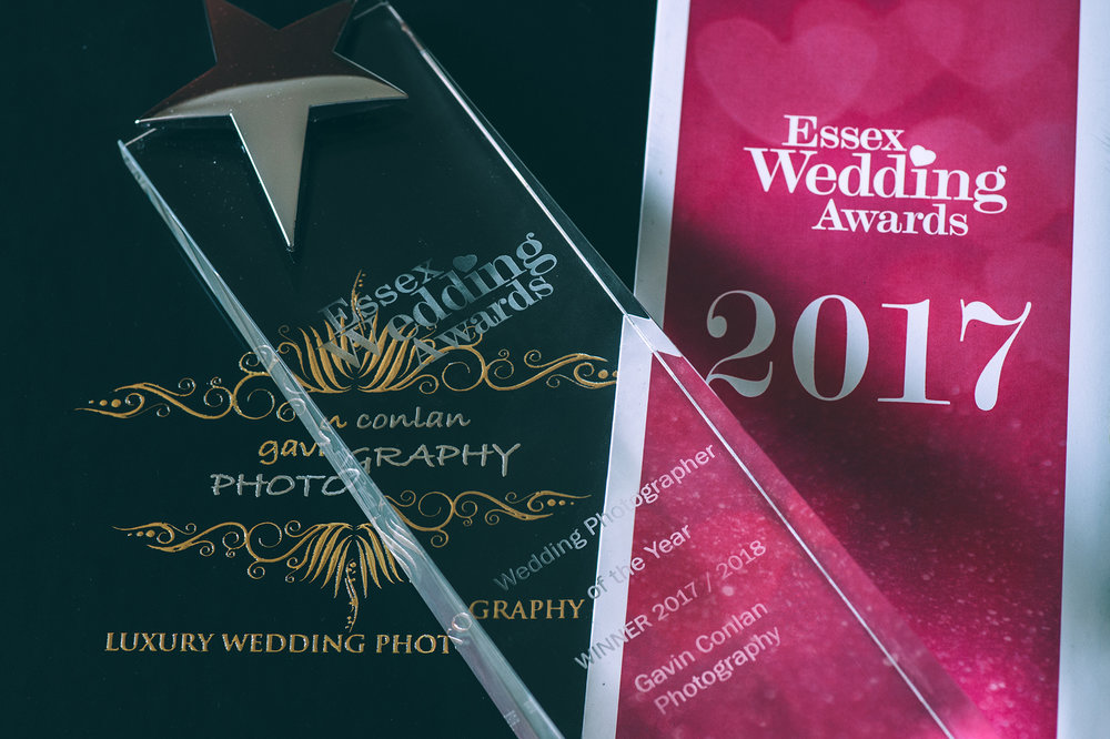 Essex Wedding Photographer of the Year trophy posed together with my logo and Essex Wedding Awards branding.