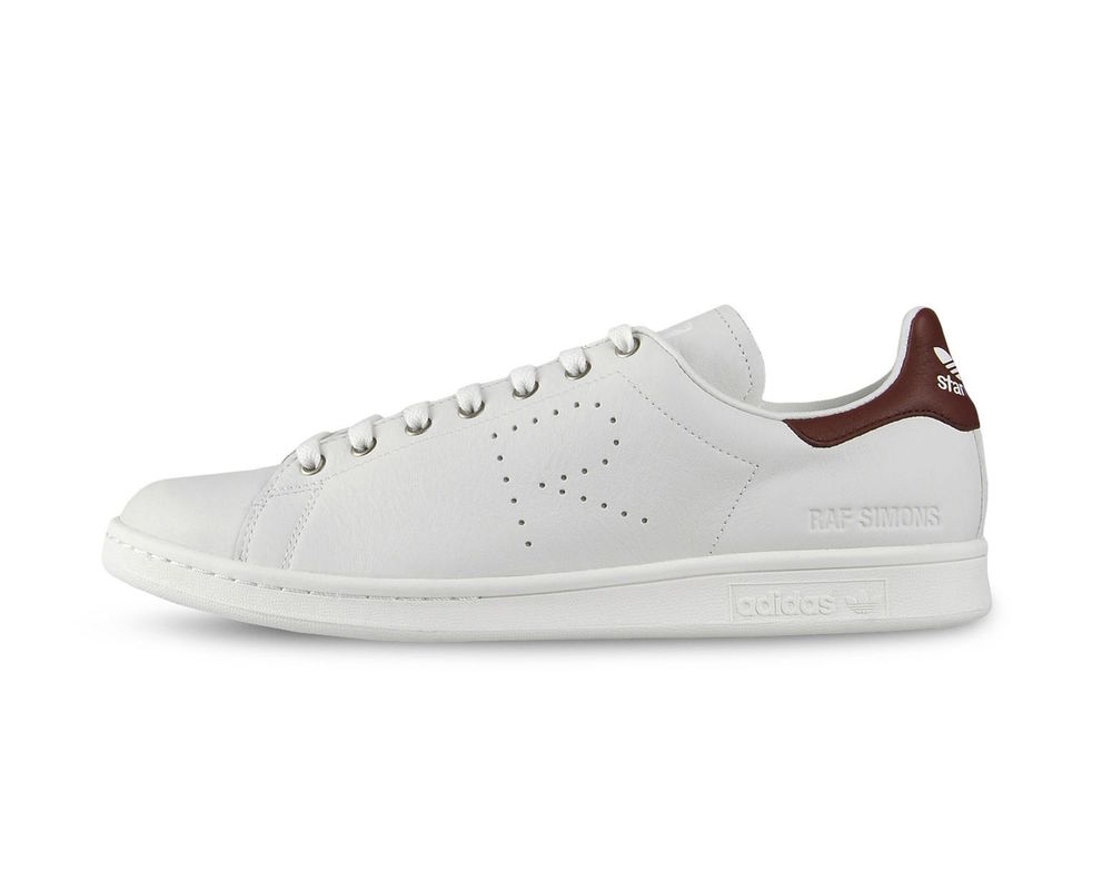 Raf Simons obsession with the Stan Smith continues. Making his mark on adidas's most coveted tennis shoe. Elegant leathers combined with the now iconic 'R' perforrated quarter and offered in burgundy with Raf Simons debossed logo at the heel. The Raf Simons Stan Smith is available now at ACD Gallery both in-store & online.