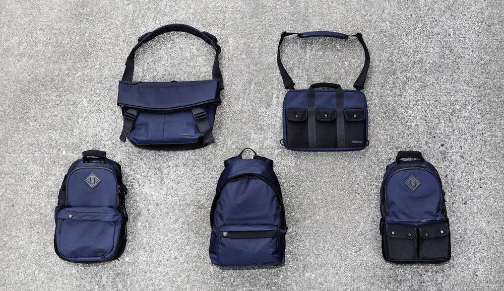 For Fall/Winter 2016, Lexdray is expanding their Symmetry Collection and adding a deep navy blue hue inspired by their love for all things maritime. The sea-worthy fabric is a custom rip-stop nylon fused with durable mesh, which gives the fabric a subtle diamond-shaped pattern, and is of course, water-resistant. The release includes three new bags—the Rome Pack, Amsterdam Brief and Mumbai Messenger—and two of Lexdray's best sellers, the Tokyo Pack and Vienna Pack. Each style comes in the signature new navy blue with a custom Lexdray heather gray lining and as always, is released in a limited run of 500 and numbered on the interior.  Available now at acdgallery.com.