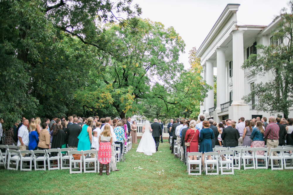 Possibly our most popular ceremony site, the private side yard, with elegant column and garden views. The Chinaberry tree provides the perfect backdrop for your nuptials, and there's room for a crowd of any size - up to 250 plus! 200 white resin chairs are included in the rental.