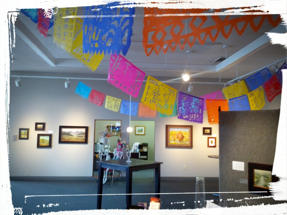 Authentic papel picado banners decorate the gallery.