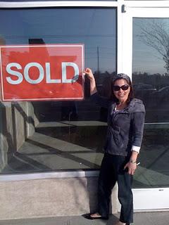 viv+in+front+of+sold+sign.jpg