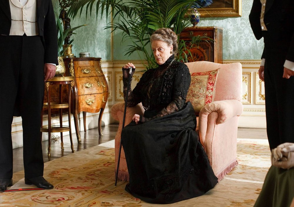 The Dowager Countess in a room with an Aubusson rug
