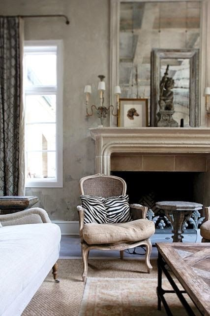 Just a bit of zebra adds some graphic interest....(I know, not leopard - but I like it!  The mantel styling is good, too)