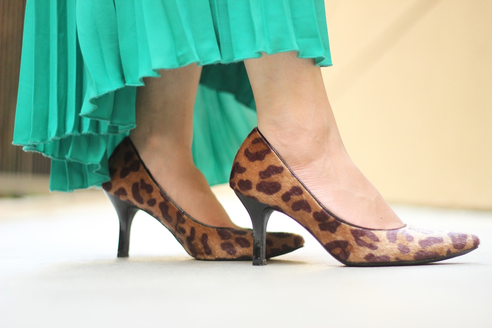 Pointed toe leopard heels, faux pony hair pumps