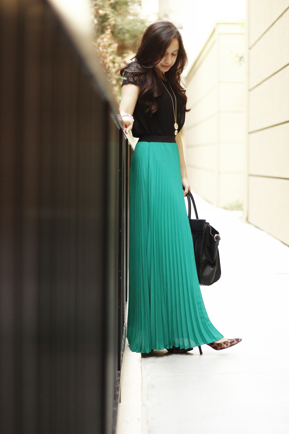Fall fashion with flowing pleated maxi skirt with leopard heels and lace blouse