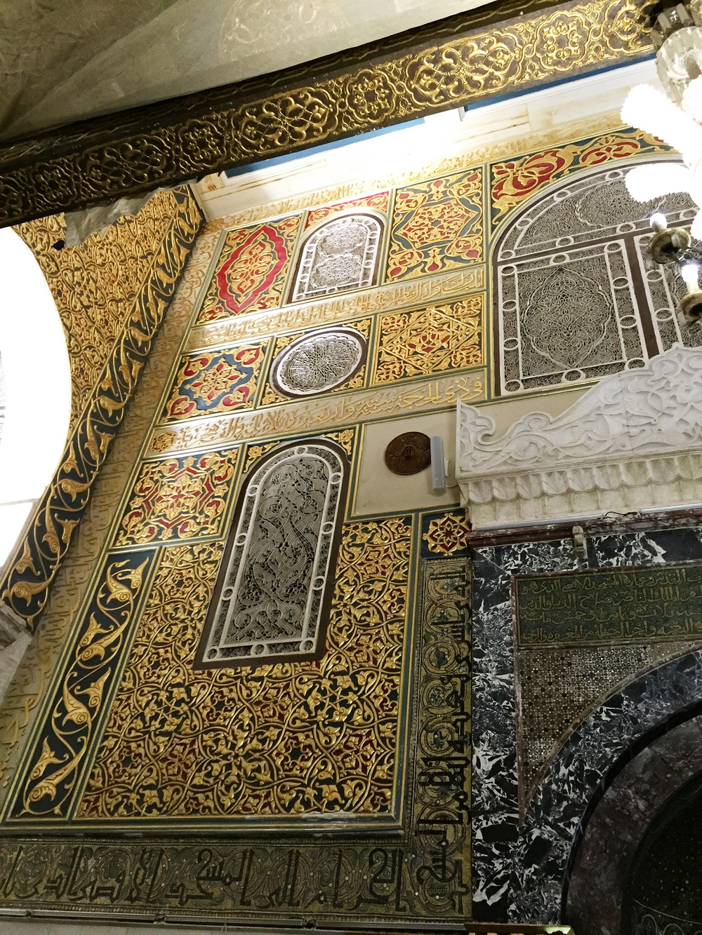 Gilded flourishes on one of the walls of Masjid Al-Aqsa