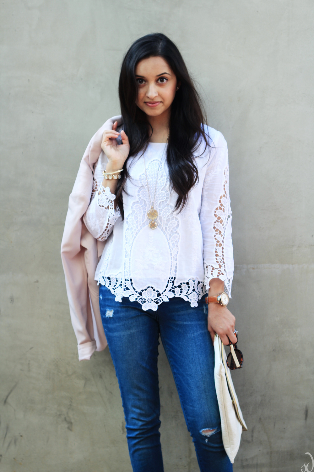 white crochet blouse, blue jeans, pink jacket