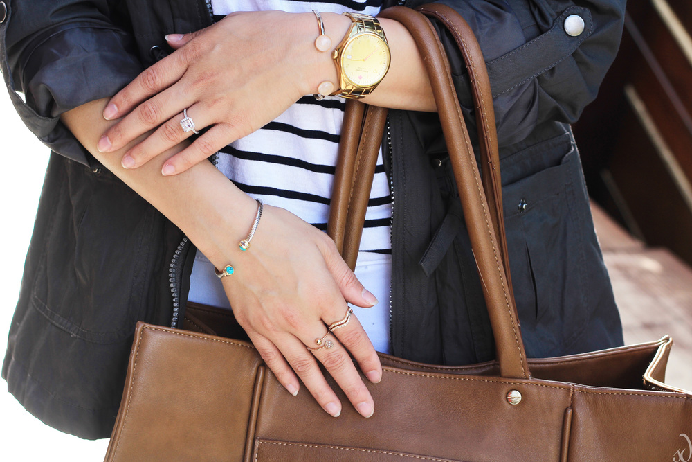 Dainty Rings, gold watch, brown tote, cuff bracelets, stripes, utility jacket, white pants