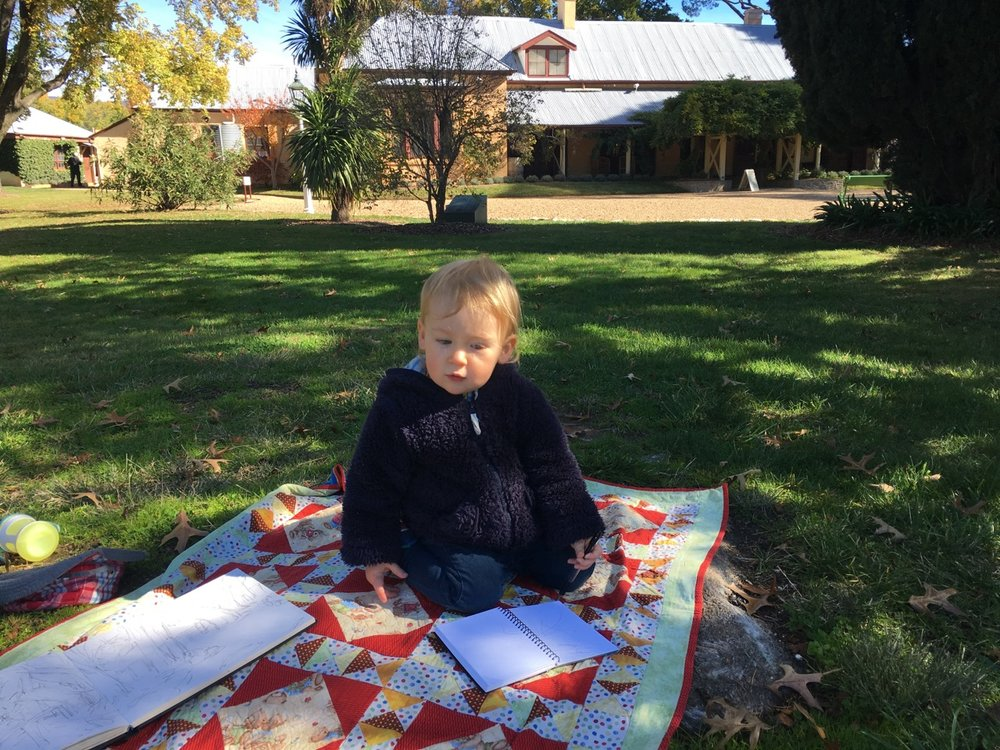 Camille drawing in front of lanyon historic homestead, Canberra 2017