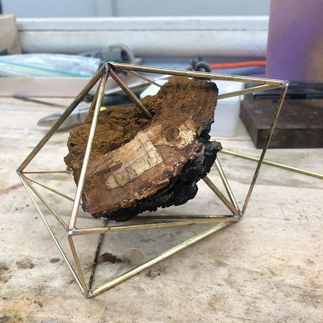 Work in progress... part of a commission for my friends at @thechagaco who wanted to join me in experimenting - the core of this piece (and of one more that I'm working on) is a piece of chaga, a mushroom with antioxidant properties. #chaga #commission #fungi #art #abstract #geometric #nature #sculpture #abstractsculpture #metalworking