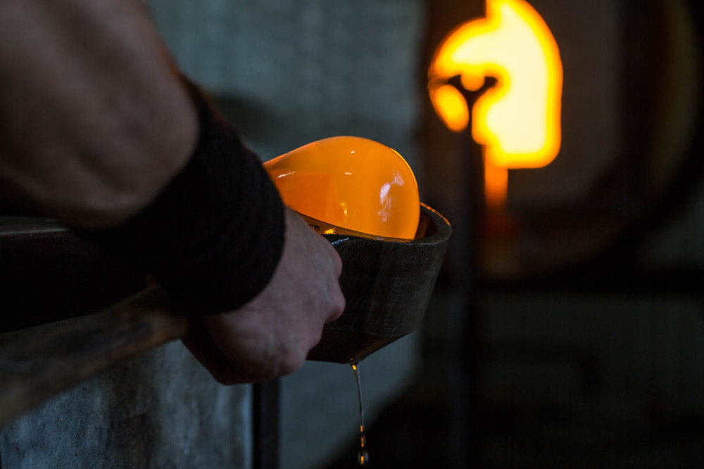 Shaping a molten glass