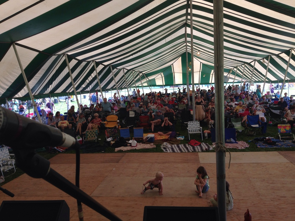 Our view from under the main stage big top  at the Sugar Maple Traditional Music Festival in Madision, WI.