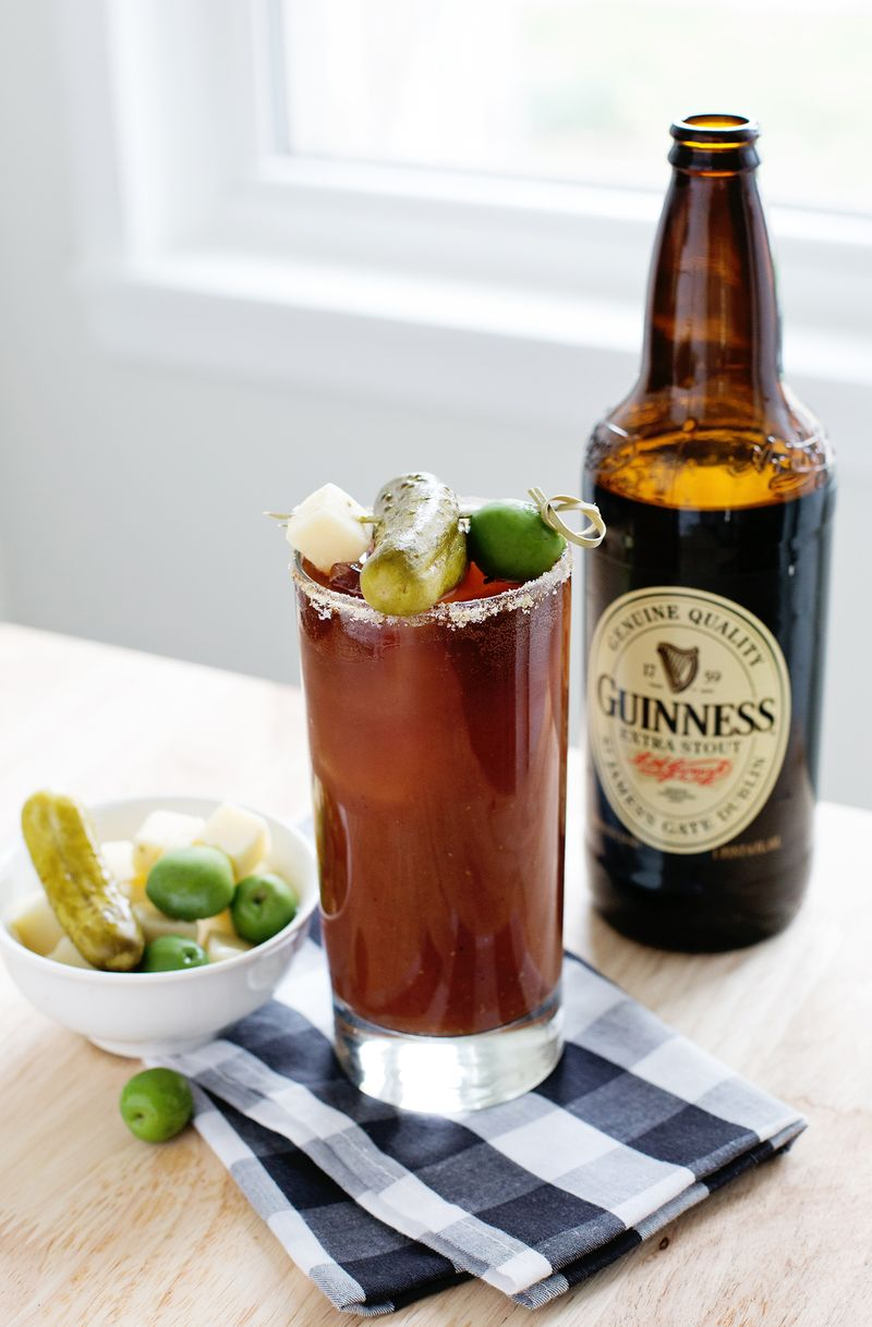 BREAKFAST -Guinness Bloody Mary - INGREDIENTS 2 cups Bloody Mary mix1 pinch garlic powder1 pinch black pepper1 pinch cayenne pepperJuice of half a lime1 ounce vodka1 drop liquid smoke1 bottle Guinness Extra Stout (you'll use 3 ounces of it)Celery salt, Dill pickle, Pepper jack cheese and OliveINSTRUCTIONSPrepare your glass with lime juice on the outside of your rim and roll it in celery salt.Prepare a cocktail stick with a pickle, olive, and square of pepper jack cheese. Set aside.In a shaker combine the Bloody Mary mix, garlic powder, black pepper, cayenne pepper, lime juice, vodka, and liquid smoke. Add ice and shake it.Pour the mixture into your prepared glass, and add ice. Pour 3 ounces of Guinness onto the top of your drink.Add your garnish.
