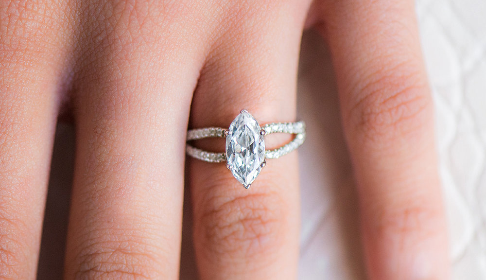 marquise-cut-diamonds-cover-split-shank-ribbon-engagement-ring.jpg
