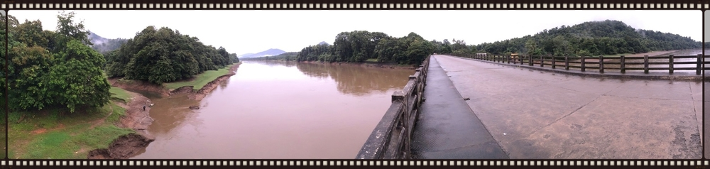 A pano from the Thatekkad bridge that overlooks the forests and mountains
