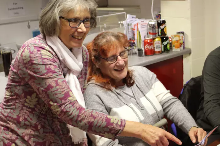 Pat Owen and Olivia Distafano look at the Age Better Sheffield Neighbourhood toolkit. The charity are supporting the Sheffield Star Know Your Neighbour Campaign.