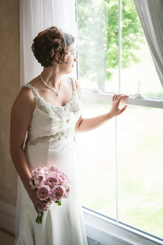 Bride gazing out of a window Doe Creek Farm Wedding, Pembroke, Virginia