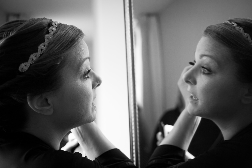 Bride applying makeup at the Main Street Inn in Blacksburg, Virginia