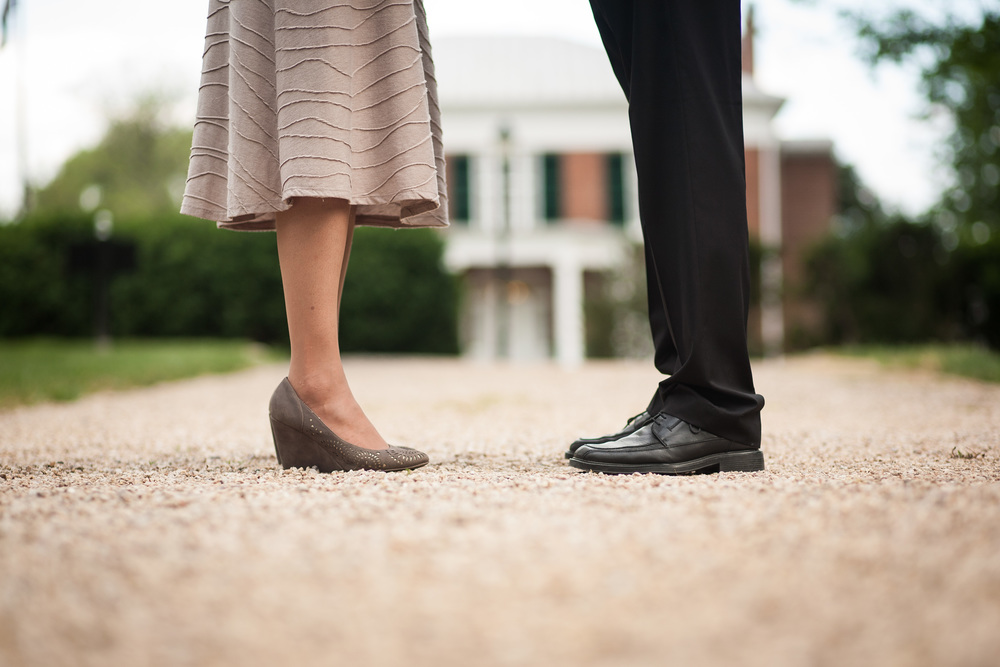 Engaged Couple legs in front of historic home in Lexington, Virginia