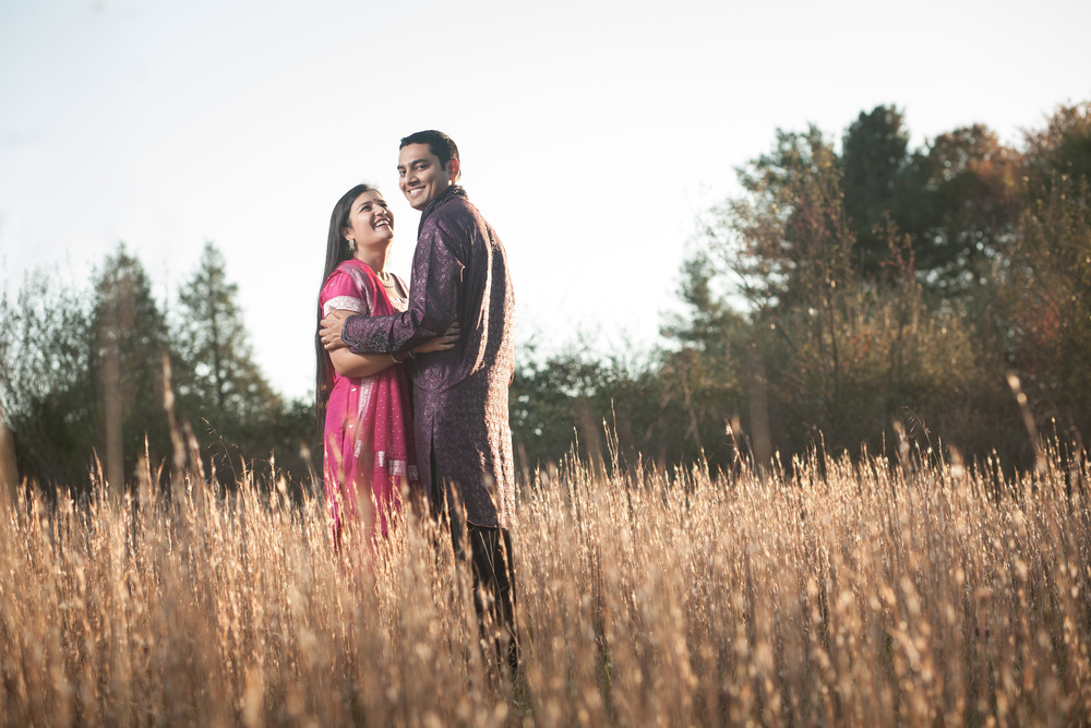 Couple in amber grain near sunset Blacksburg Virginia Portrait and Wedding Photographer Bent-Lee Carr