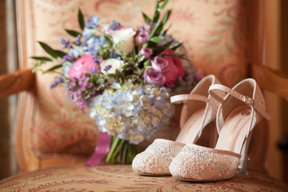Wedding shoes and a bridal bouquet at L'auberge Provencale bed and breakfast near winchester, virginia