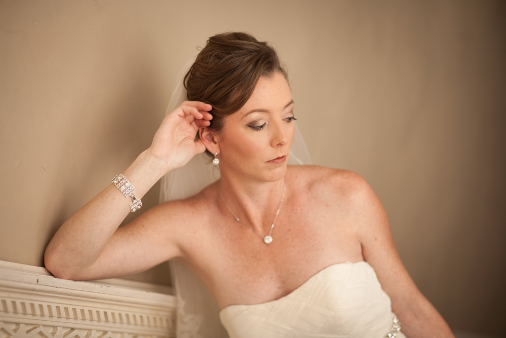 wedding photographer bent-lee carr the kyle house fincastle virginia serious bride leaning on staircase