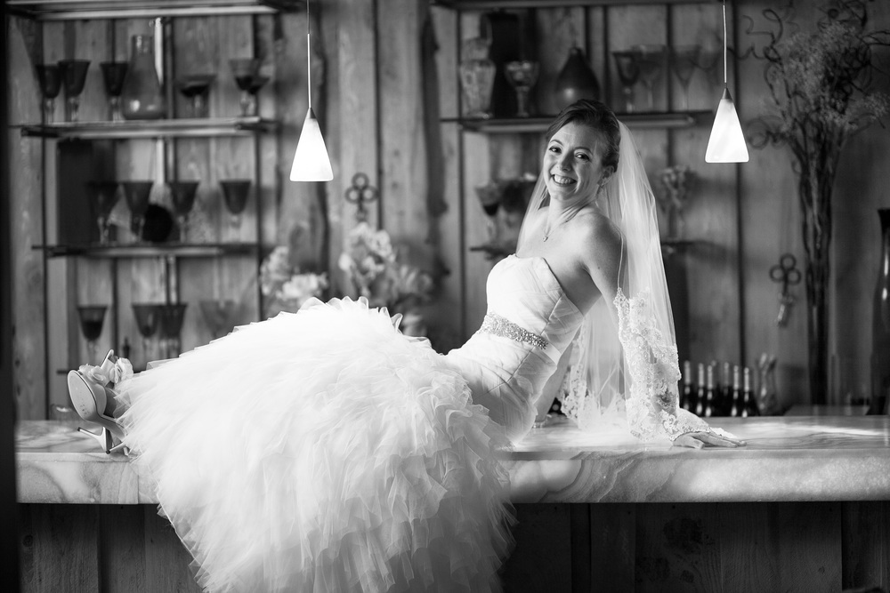 wedding photographer bent-lee carr bride on the bar at the kyle house in fincastle virginia