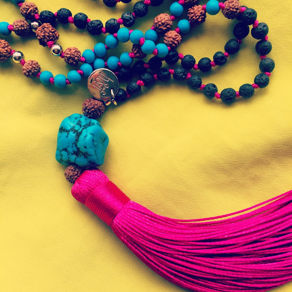 Helix and Felix cerise pink tassel necklace.