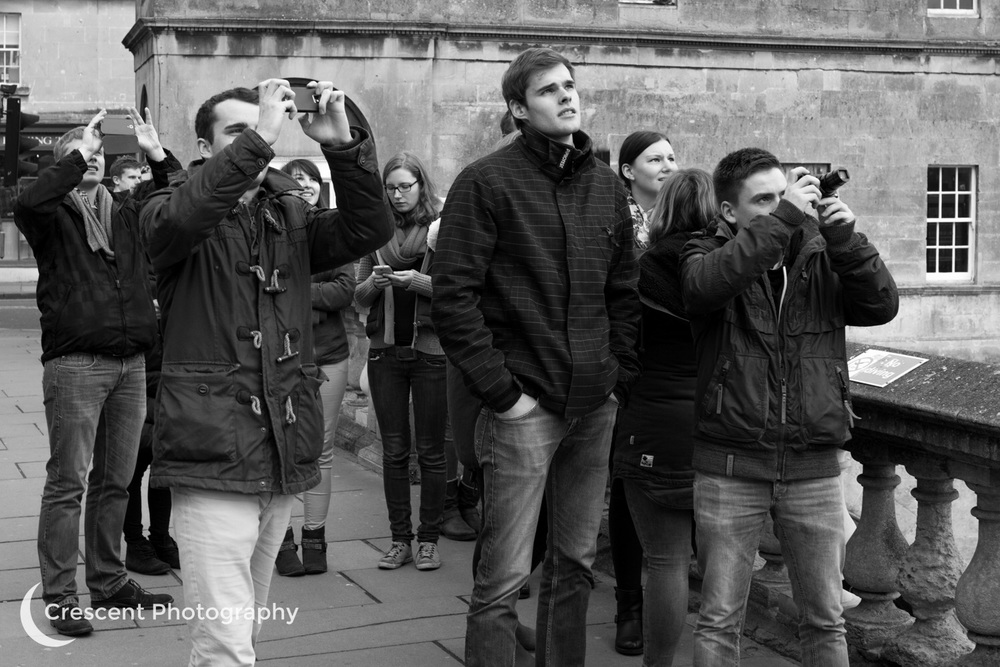 Tourists looking at the eclipse, Pulteney Bridge