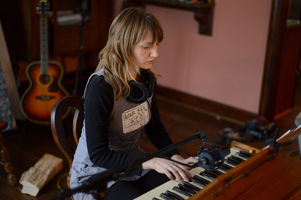 Jennie on antique pump organ