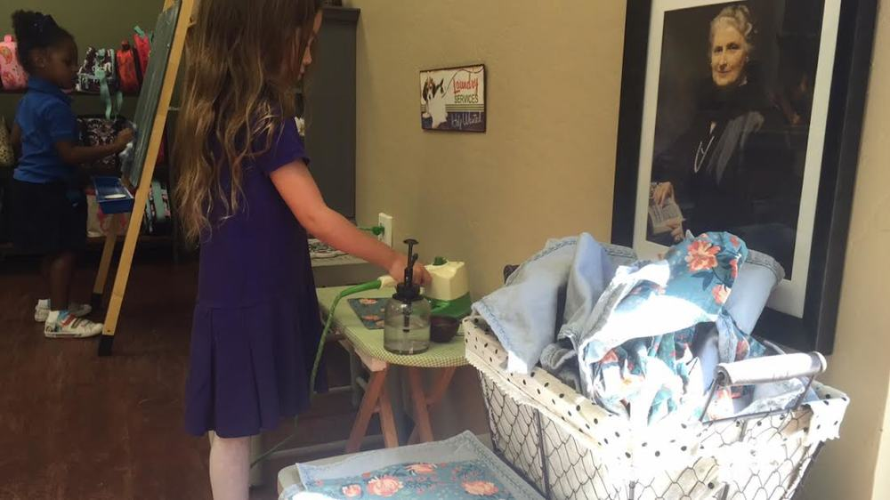 Ironing away - this is an important presentation for lunch preparation. Concentration and control of movement are elequently exhibited as the child meticulously contributes to the environment.